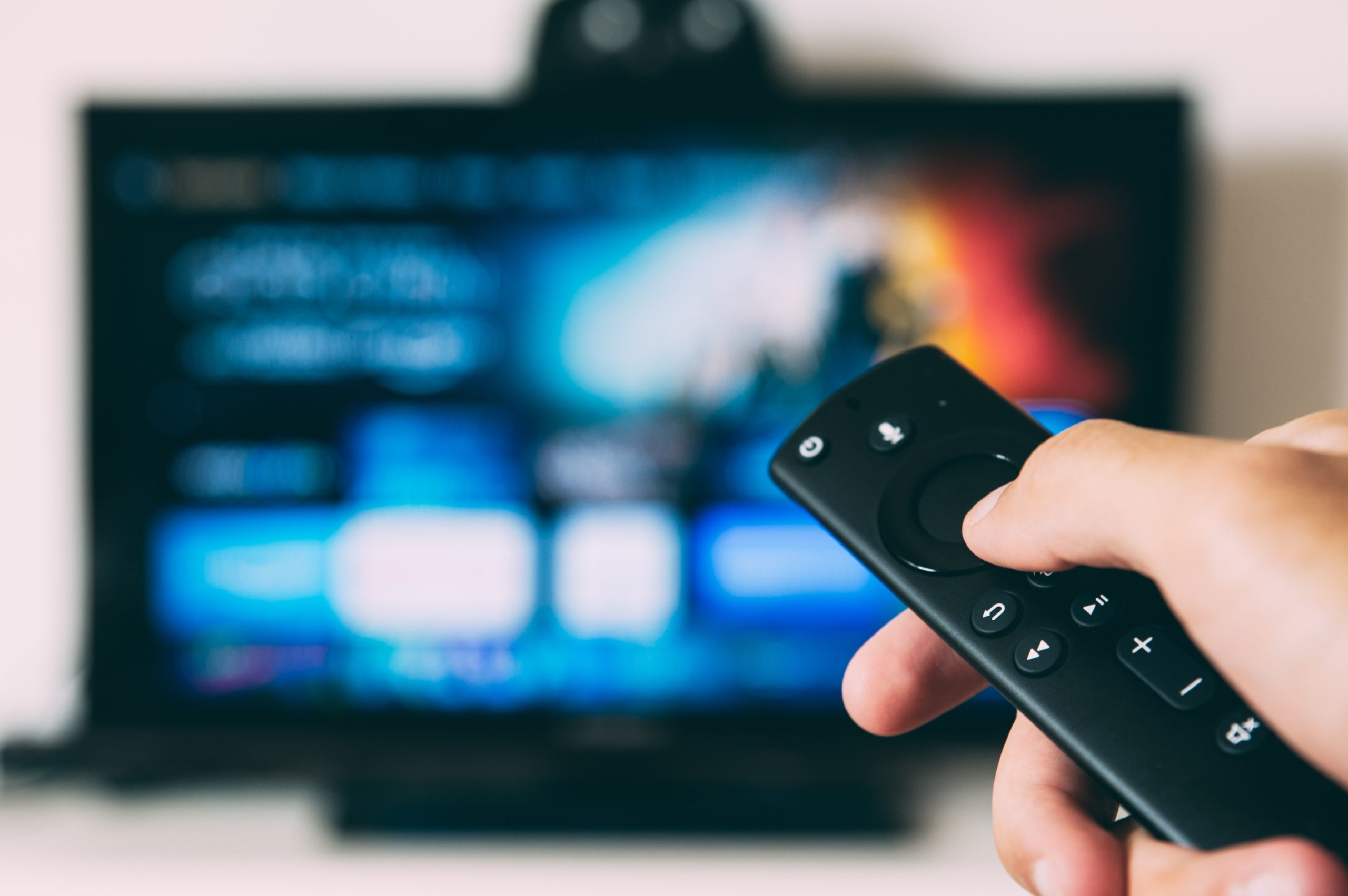 Hand holding a TV Streaming remote